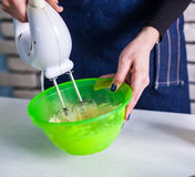 Mixing  egg cream in bowl with motor mixer Stock Photography
