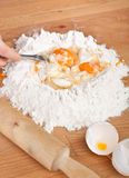 Mixing Eggs into the Pastry Royalty Free Stock Images