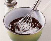 Mixing the flour and the melted chocolate Royalty Free Stock Photography