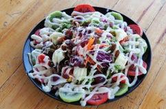Mixing Fruit Salads Royalty Free Stock Photo