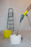 Mixing glue with a power drill Royalty Free Stock Photography