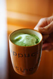 Mixing Green Barley Grass Powder in man hand. Juice for Vitality Health Stock Photography