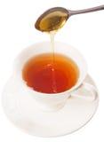 Mixing Honey With Tea II Stock Photography