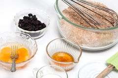 Mixing ingredients to prepare integral wheat bran muffins. Wheat bran muffins preparation : Mixing ingredients to prepare integral wheat bran muffins Stock Images
