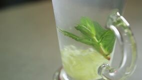 Ginger drink close up. Mixing lemon, mint, ginger, water and sugar Close up stock video