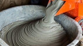 Mixing mortar in bucket Stock Photos