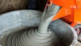 Mixing mortar in bucket Stock Photo