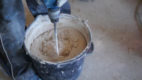 Mixing mortar on workplace stock video footage