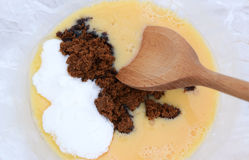 Mixing muscovado and caster sugar into beaten eggs royalty free stock photo
