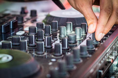 Mixing music on console at the night club Royalty Free Stock Photo