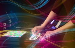 Mixing music on midi controller with colorful vibe concept. Hand mixing music on midi controller with colorful vibe concept stock photos