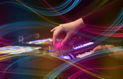 Mixing music on midi controller with colorful vibe concept. Hand mixing music on midi controller with colorful vibe concept stock photography