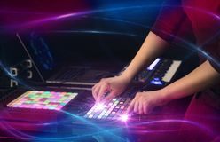 Mixing music on midi controller with wave vibe concept. Hand mixing music on midi controller with wave vibe concept royalty free stock images
