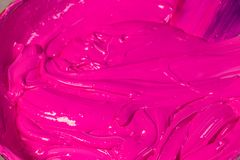 Mixing a new light pink color. By put white color pink color and purple color in clean barrel then stir royalty free stock images