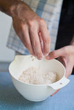 Mixing oatmeal and icing sugar Royalty Free Stock Images