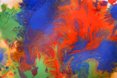 Mixing of paints different colors on a white paper Stock Photography