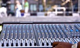 Mixing panel at a concert. A mixing panel at a live concert for regulating music and sound coming from the different instruments Royalty Free Stock Photography