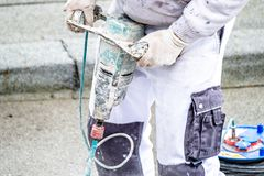 Mixing plaster solution in a bucket, using an electric drill royalty free stock images