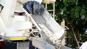 Mixing and pour cement by cement truck. In construction site stock video footage