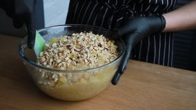 Mixing products for the cake dough, the complete process of making a cake, stock footage. Mixing products for the cake dough, mix eggs, flour, sugar, nuts stock video footage