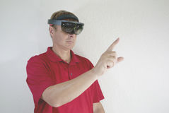 Mixing reality. Man working with smart glasses. creating virtual reality. mixing real and dream Stock Photos