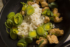 Mixing rice and chicken Stock Images