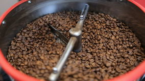 Mixing roasted coffee. Coffee roaster cooling down freshly roasted coffee beans