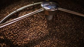 Mixing roasted coffee stock footage
