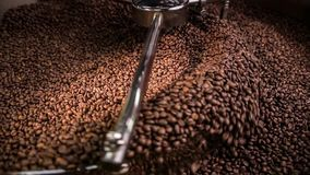 Mixing roasted coffee stock video