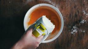 Mixing scrambling yolks Eggs stock footage