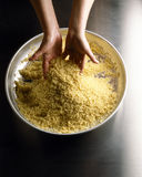 Mixing the semolina. Food, gastronomy, cooking,cookery Royalty Free Stock Images