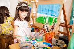 Mixing some colors in art class Royalty Free Stock Image