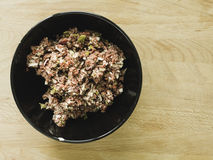 Mixing steak tartare ingredients in a bowl Royalty Free Stock Photography