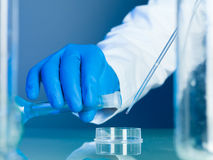 Mixing substances in the lab Royalty Free Stock Photography