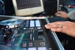Mixing table and disc jockey hands Stock Photos