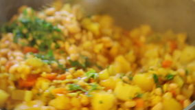 Mixing vegetable dish with beans stock footage