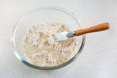 Mixing water and bread flour mix Royalty Free Stock Photo
