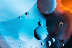 Mixing water and oil, beautiful color abstract background based on circles and ovals, macro abstraction. Mixing water and oil, beautiful color abstract Stock Images