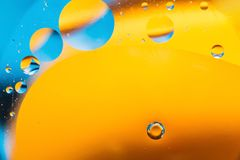 Mixing water and oil, beautiful color abstract background based on circles and ovals, macro abstraction. Mixing water and oil, beautiful color abstract Royalty Free Stock Image