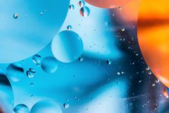 Mixing water and oil, beautiful color abstract background based on circles and ovals, macro abstraction. Mixing water and oil, beautiful color abstract Royalty Free Stock Photography