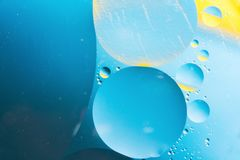 Mixing water and oil, beautiful color abstract background based on circles and ovals, macro abstraction. Mixing water and oil, beautiful color abstract Royalty Free Stock Images
