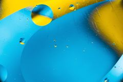 Mixing water and oil, beautiful color abstract background based on circles and ovals, macro abstraction. Mixing water and oil, beautiful color abstract Stock Photo