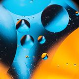 Mixing water and oil, beautiful color abstract background based on circles and ovals, macro abstraction. Mixing water and oil, beautiful color abstract Royalty Free Stock Photo