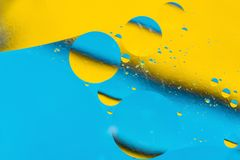 Mixing water and oil, beautiful color abstract background based on circles and ovals, macro abstraction. Mixing water and oil, beautiful color abstract Royalty Free Stock Photos