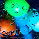 Mixing water and oil on a beautiful color abstract background gradient balls circles and ovals stock photography