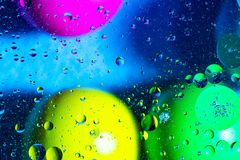 Mixing water and oil on a beautiful color abstract background gradient balls circles and ovals stock photos