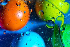 Mixing water and oil on a beautiful color abstract background gradient balls circles and ovals royalty free stock photo