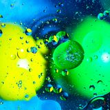 Mixing water and oil on a beautiful color abstract background gradient balls circles and ovals stock image