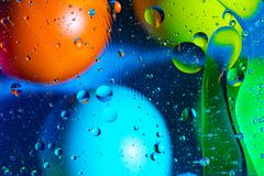 Mixing water and oil on a beautiful color abstract background gradient balls circles and ovals royalty free stock image