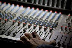 Mixingdesk and human hand. On the concert Stock Photos